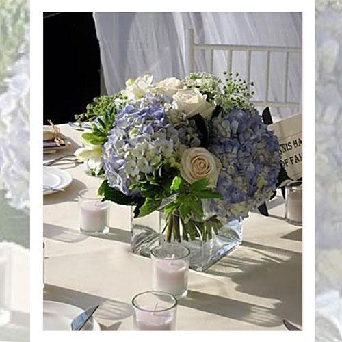 Imagen de Centros de mesa con flores lila floristería florilandia express