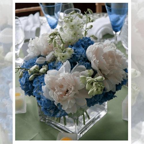 Imagen de Centros de mesa con flores purple floristería florilandia express