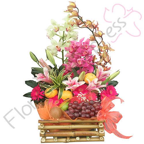 Imagen de Arreglo de flores y frutas Argelia - Floristería florilandia express