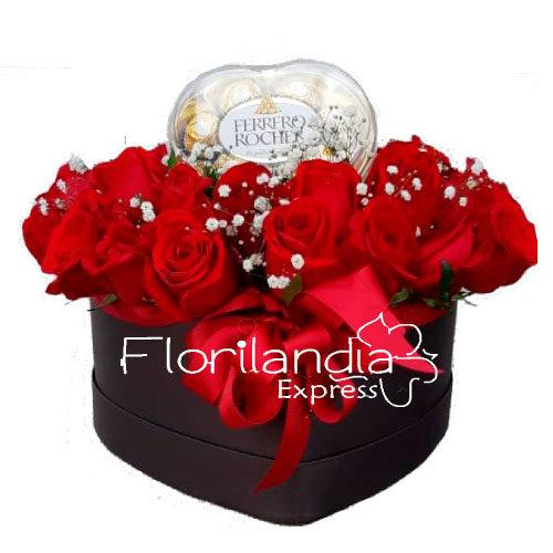 Hermoso corazon de rosas rojas con chocolates ferrero